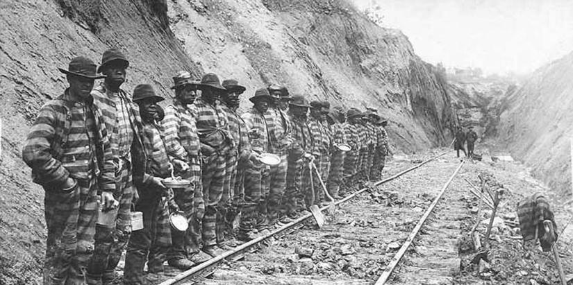 Convict labor working on railroad line